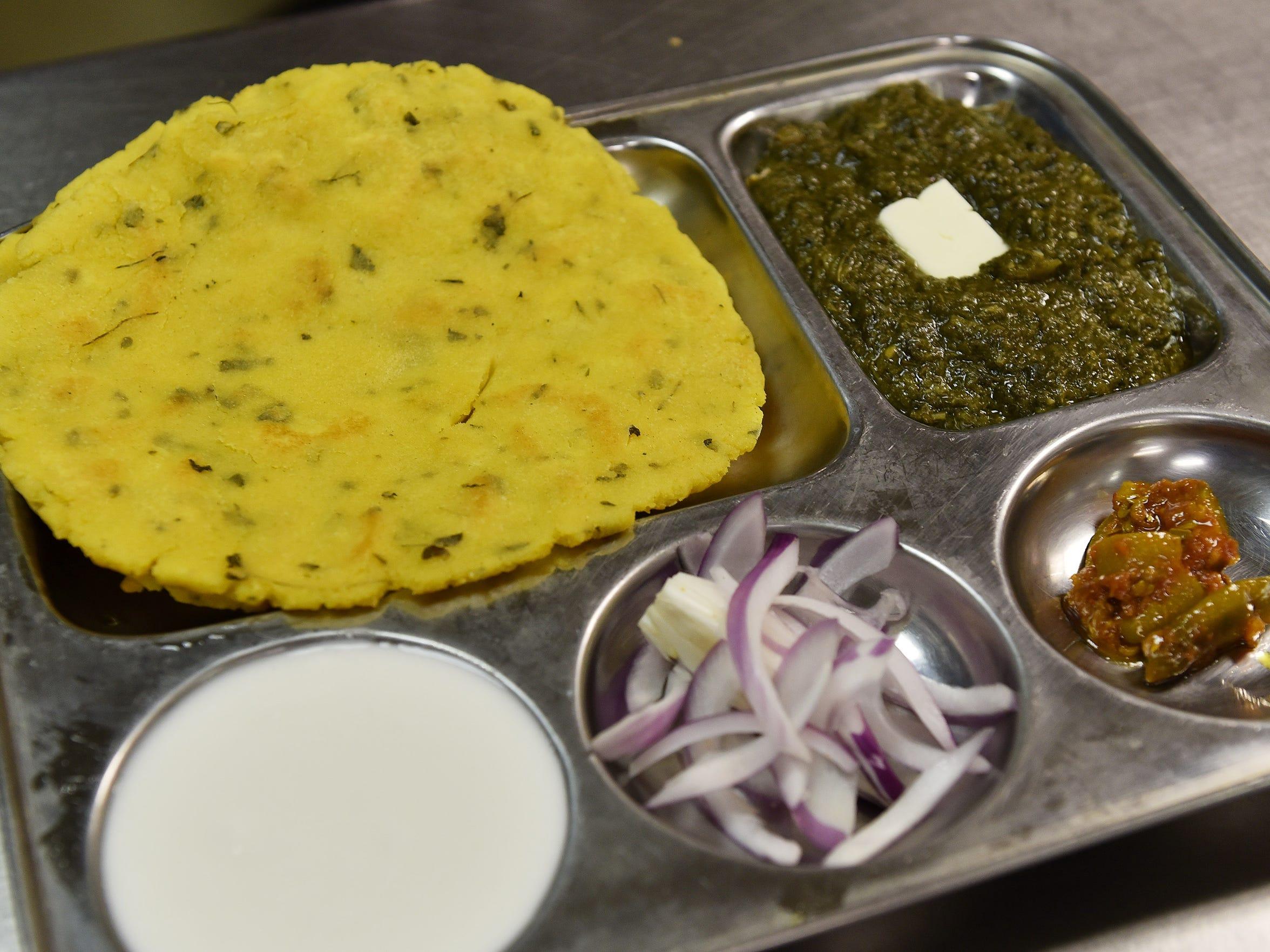 Maki Roti & Saag is Punjabi corn bread served with cooked mustard greens at Phulkari Punjabi Kitchen in Madison Heights.
