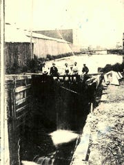 """Canal construction workers sit atop the canal """"spill"""