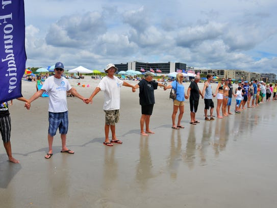 About 75 people showed up for Hands Across the Sand at Lori Wilson Park in Cocoa Beach Saturday, to show their support for the environment and stand against offshore drilling and offshore seismic testing in 2016.