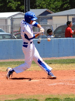 Carlsbad's Jordin Molina hits an RBI single in game two Saturday against Gadsden.