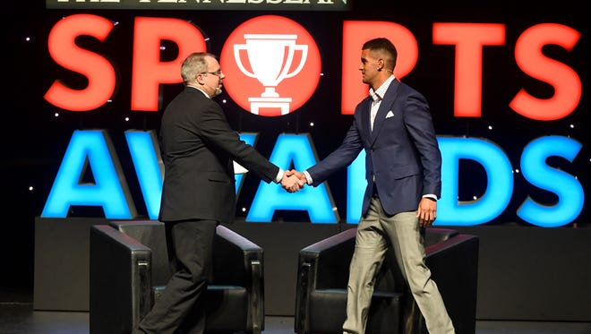 Sports Director Dave Ammenheuser shakes hands with Titans quarterback Marcus Mariota at The Tennessean Sports Awards presented by Farm Bureau Health Plans at the Tennessee Performing Arts Center's Andrew Jackson Hall on Tuesday, June 6, 2017.