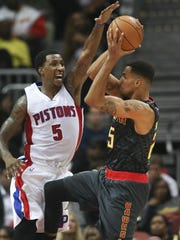 Rising to the occasion, Pistons guard Kentavious Caldwell-Pope attempts to block a shot by Atlanta's Thabo Sefolosha.