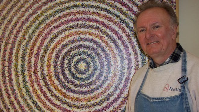 "Artist Denny Smith is shown with his painting titled ""BC Target."" It will not be in his show at the Gmeiner, but another five from his random choice series will be."