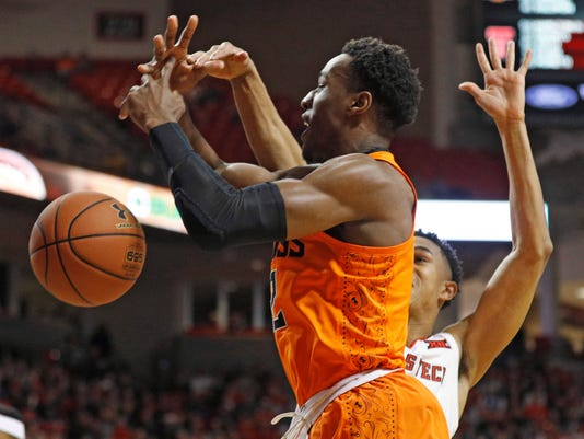 Texas Tech's Zhaire Smith, rear, blocks a shot by Oklahoma State's Cameron McGriff during the first half of an NCAA college basketball game Tuesday, Jan. 23, 2018, in Lubbock, Texas. (AP Photo/Brad Tollefson)