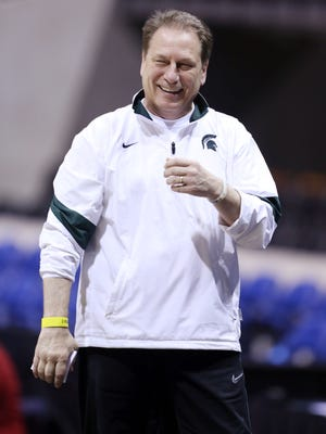 Michigan State Spartans head coach Tom Izzo arrived at Michigan State's annual Midnight Madness event riding on top of a cannon.