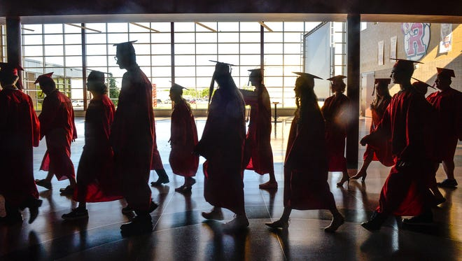 Rocori High School graduates make their way into the school's gymnasium for their graduation ceremony Saturday, June 3, in Cold Spring.