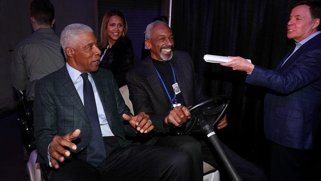 Julius Erving arrives with Darnell Hillman and is greeted by Bob Costas,right, during the ABA 50th anniversary reunion at Bankers Life Fieldhouse on Saturday, April 7, 2018.
