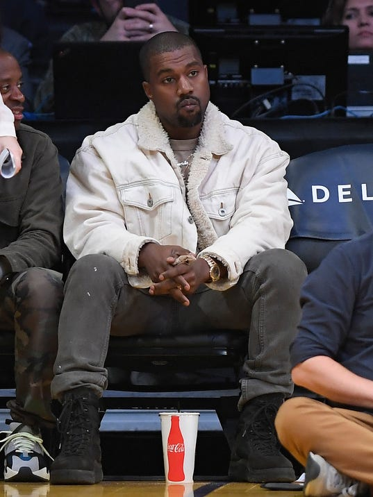 Kanye West watches during the first half of an NBA basketball game between the Los Angeles Lakers and the Memphis Grizzlies, Sunday, Nov. 5, 2017, in Los Angeles. (AP Photo/Mark J. Terrill)