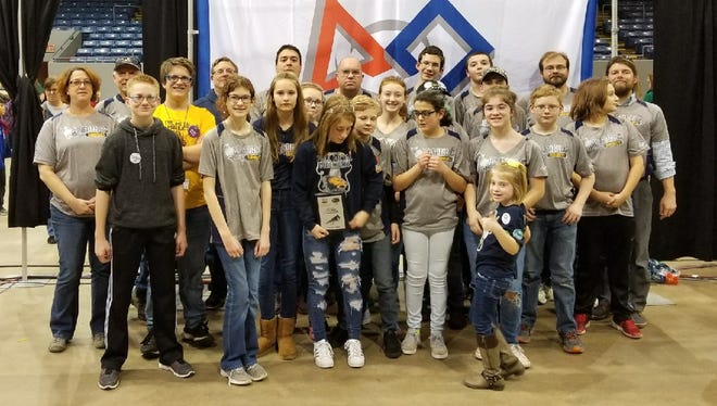 Members of the Algonac RoboRats robotics team pose for a group photo at the 2017 FIRST in Michigan FTC State Championship held in Battle Creek, Michigan, on Friday and Saturday, Dec. 15 and 16, 2017.
