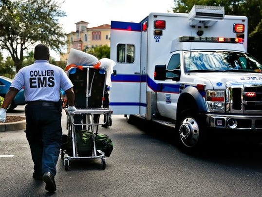 Collier County paramedics work a medical call in Naples on Wednesday, September 23, 2015. (Scott McIntyre/Staff)