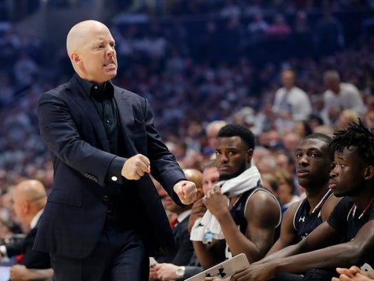 Cincinnati Bearcats head coach Mick Cronin paces his