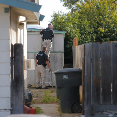Salinas Police Department officers attempt to coax
