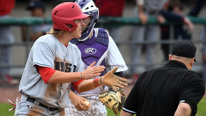 Southern Indiana's Drake McNamara (33) after a first-inning score as against the Evansville Aces at Braun Stadium, Wednesday, April 25, 2018.