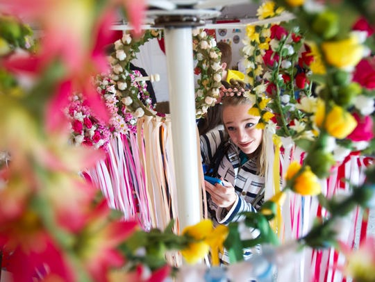 Abby Heinzen tries on traditional Polish flower wreaths