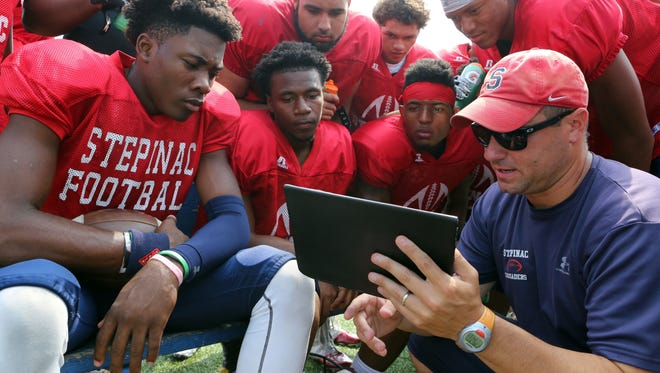 Joe Spagnolo is shown reviewing plays during football practice at Stepinac High School on Aug. 31, 2015  in White Plains. Spagnolo was named Iona Prep's new football coach on Monday.
