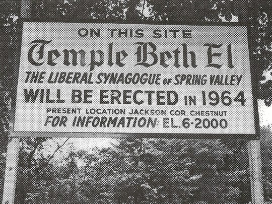 A photo of a sign  in 1964 indicating where Temple Beth El was to construct its second temple in Spring Valley at 415 Viola Road. The building will be put up for auction in June.