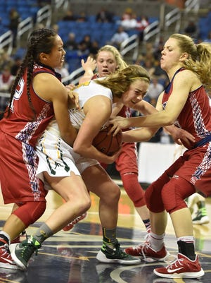 Bishop Manogue's Malia Holt battles for a rebound against Liberty's Shaena Kapanui, left, and Amanda Pemberton during the first half of the 2016 NIAA Division State Basketball Championships at Lawlor Events Center on Thursday.