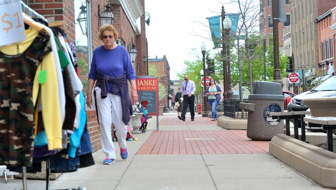 Instead of using the sidewalks along Third Street, pedestrians will be able to walk down the middle of the street.