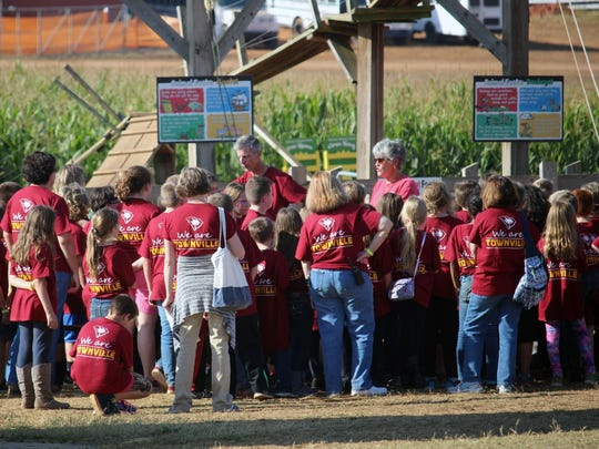 Townville Elementary School students gather around two teachers Thursday at Denver Downs Farm near Anderson.