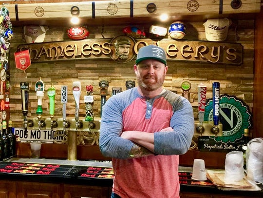 Co-owner Chris Hastings at the bar at Shameless O'Leery's.