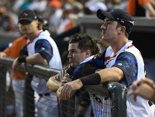 Cadyn Grenier (center) watches from the Delmarva Shorebirds'