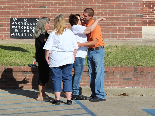 Chris Few, right, greets members of the Avoyelles Watchdogs