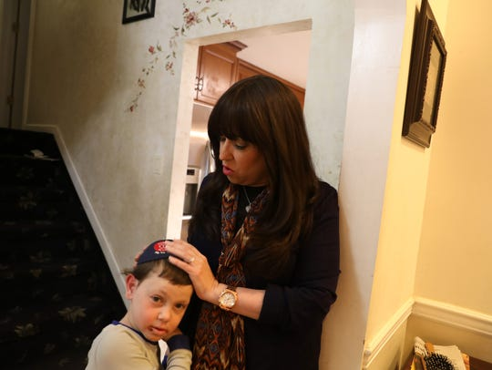 Rivkie Feiner with her youngest son, Aharon, 6, at