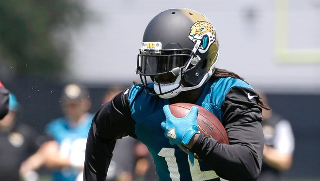 Jacksonville Jaguars running back Denard Robinson gains yardage in a scrimmage during NFL football training camp, Thursday, July 28, 2016, in Jacksonville, Fla.