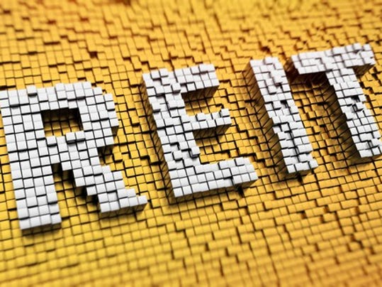 pixelated-acronym-reit-made-from-cubes-mosaic-pattern_large.jpg