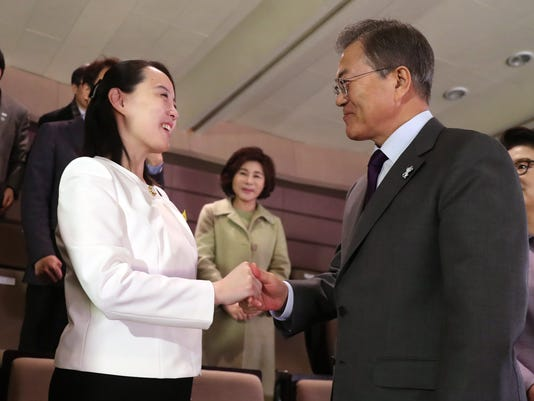 """South Koran President Moon Jae-in, right shakes hands with Kim Yo Jong, North Korean leader Kim Jong Un's sister, after a performance of North Korea's Samjiyon Orchestra at National Theater in Seoul, South Korea, Sunday, Feb. 11, 2018. A rare invitation to Pyongyang for South Korea's president marked Day Two of the North Korean Kim dynasty's southern road tour, part of an accelerating diplomatic thaw that included some Korean liquor over lunch and the shared joy of watching a """"unified"""" Korea team play hockey at the Olympics. (Bee Jae-man/Yonhap via AP)"""