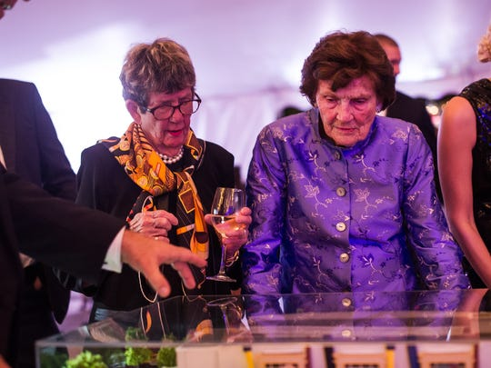 Lavern Norris Gaynor, right, looks at a model during the YMCA's Gold Garden Gala at the Naples Botanical Garden in Naples, Fla., on Saturday, Feb. 18, 2017. The Gold Garden featured special guests, including Naples resident, and YMCA member Michelle Konkoly, who won multiple gold medals at the 2016 Paralympic Games in Rio de Janeiro, along with Dr. James Naismith Jr., the grandson of the inventor of basketball.