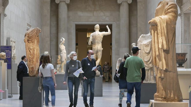 Two visitors wear masks as they walk through the Metropolitan Museum of Art in New York on March 10.