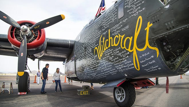 People look at a B-24J Liberator World War II bomber that is part of the Wings of Freedom Tour, now at Phoenix Deer Valley Airport, on  April 11, 2017. Three other rare warbirds are on display through April 13, 2017. The vintage craft are a Boeing B-17 Flying Fortress, a North American B-25 Mitchell and a P-51 Mustang. The stop is part of a 110-city tour.
