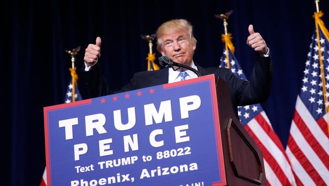 Republican presidential candidate Donald Trump gives two thumbs up while speaking to a crowd during his rally at the Phoenix Convention Center in Arizona on Aug. 31, 2016.