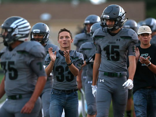 Grape Creek Eagle Ryan Folds cheers to his teammates on the sidelines during Friday night's game against TLCA in Grape Creek Sept. 15, 2017.