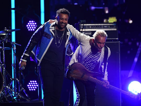 "Sting and Shaggy perform ""Englishman in New York"" during the 60th Annual Grammy Awards at Madison Square Garden."