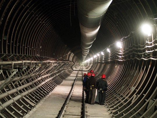 This 2002 file photo shows a group of Japanese scientists examining a fault that had been discovered in the wall of one of the exploratory tunnels carved out of the interior of Yucca Mountain.