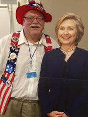 Carl Donovan of the Cascade County Democratic Central Committee stands by a a cutout of Hillary Clinton on Saturday, shortly after he was named a Clinton delegate at the Democratic National Convention in July.