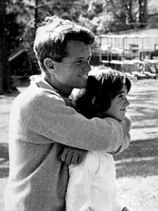 Robert Kennedy hugs his oldest child, Kathleen, who says she thinks she was 13 when the photo was taken.