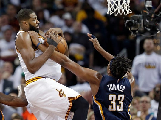 Cleveland Cavaliers' Tristan Thompson, left, drives to the basket against Indiana Pacers' Myles Turner in the second half in Game 2 of a first-round NBA basketball playoff series, Monday, April 17, 2017, in Cleveland. The Cavaliers won 117-111. (AP Photo/Tony Dejak)