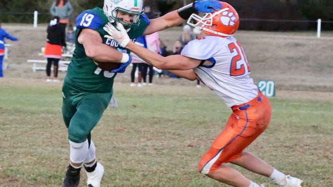 Carson Hamby stiff-arms a defender during Thursday's win against Otis-Bison.