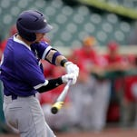 A Northwestern State player takes a swing during the Demons' win over Nicholls State on Thursay.