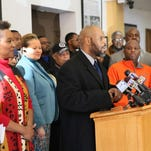 Michael McGee Jr. (at podium) and other African-American leaders said they plan to hold mayoral candidates to an agenda of economic growth in their community and distanced themselves from Ald. Joe Davis' endorsement of Ald. Bob Donovan.