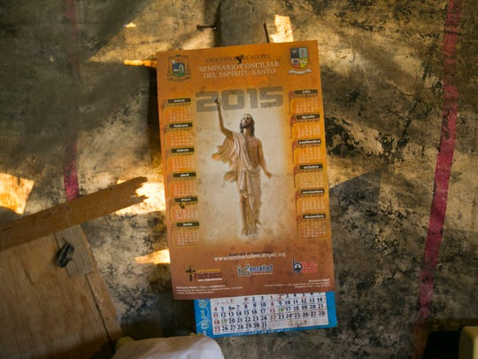 A calendar with an image of Jesus Christ hangs on the
