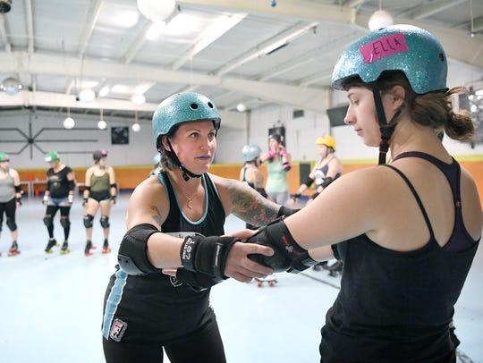 Dixie Kicks, Crystal Provenzano, helps Ella Conder