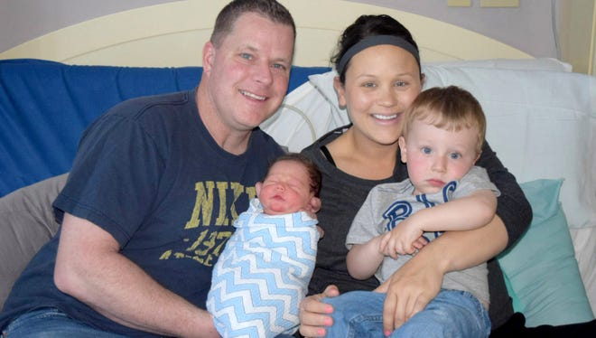 Darren and Sarah Tode and their two sons, newborn Logan and his 2-year-old brother, Nolan, at Aurora West Allis Medical Center. Both boys were born on Mother's Day.
