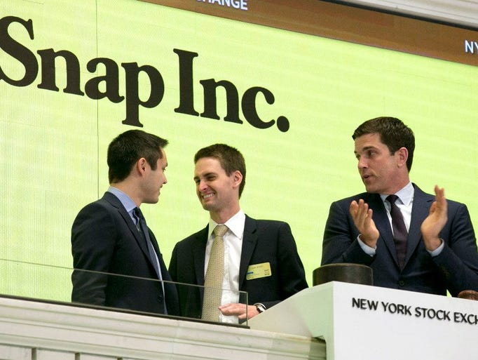 Snapchat co-founders Bobby Murphy, left, and CEO Evan