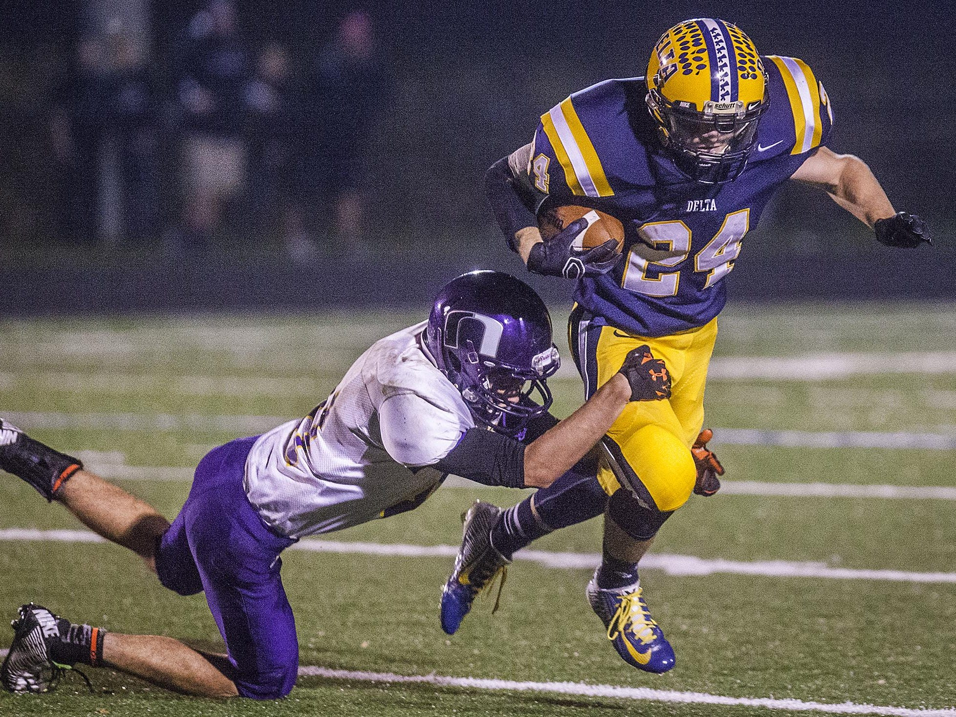 Delta's Zach Mills, right, tries to get past a Northwestern defensive player during a 2014 sectional game.
