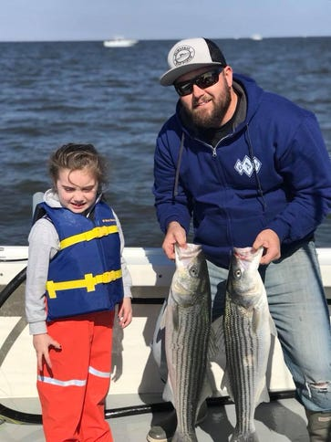 Captain Kris Black of Fish Stix charters (right) and
