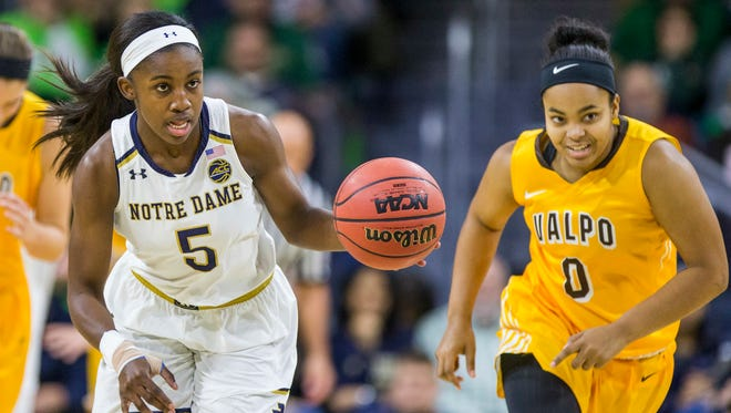 Notre Dame's Jackie Young (5) drives downcourt after stealing the ball from Valparaiso's Maya Meredith (0) during the first half of an NCAA college basketball game Sunday, Dec. 4, 2016, in South Bend, Ind. (AP Photo/Robert Franklin)